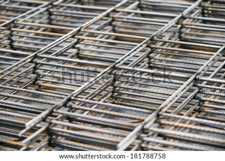 heap of metal steel reinforcing rods lattice background