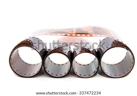 Heap of  35 mm film isolated on white background - stock photo