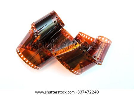 Heap of  35 mm film isolated on white background