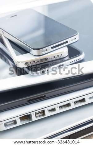 heap  of modern electronical gudgets close up - technology concept - stock photo