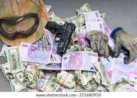Heap of money and handgun - stock photo