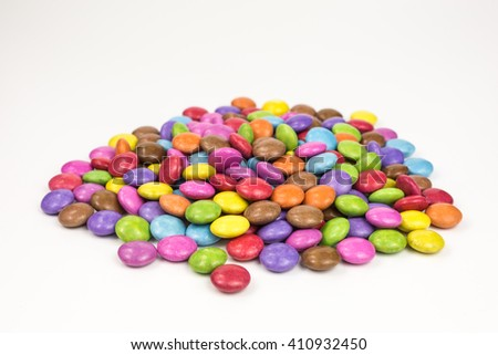 heap of multicolored sugar coated candies - stock photo