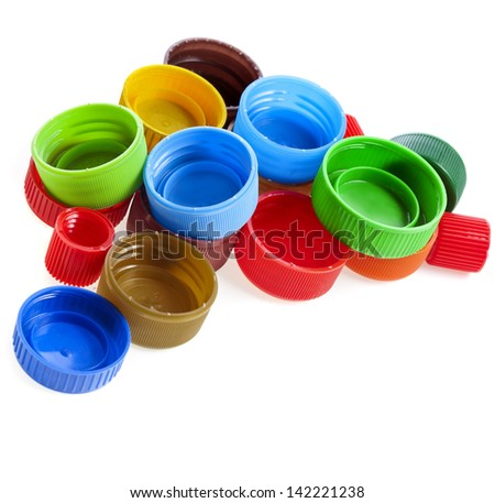 heap of multicolored used plastic bottle caps on white background - stock photo