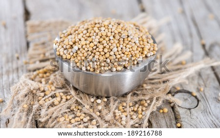 Heap of Mustard Seeds (detailed close-up shot) - stock photo