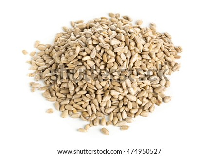 Heap of natural shelled sunflower seeds over white background