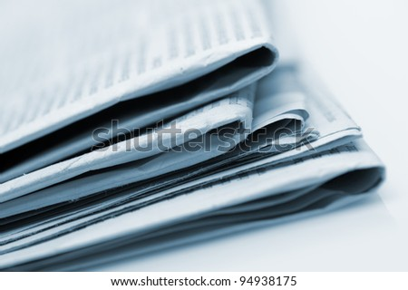 Heap of newspapers. Blue toned. A photo close up. Selective focus - stock photo