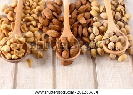 Heap of nuts in the wooden ladle  - stock photo