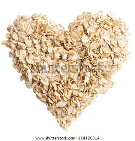 heap of oat flakes in a shape of heart shot from above - stock photo