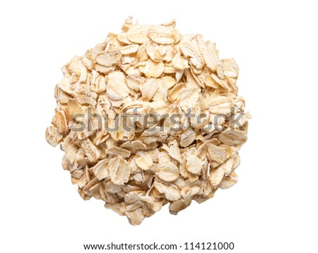 heap of oat flakes isolated on white background from above - stock photo