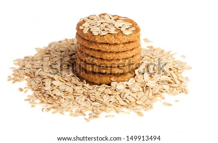 heap of oats and biscuits on a white background