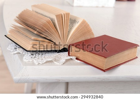 Heap of old books on table close up - stock photo