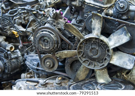 heap of old car parts in a thai Chinatown - stock photo