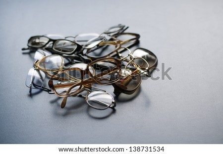 Heap of old eyeglasses - stock photo
