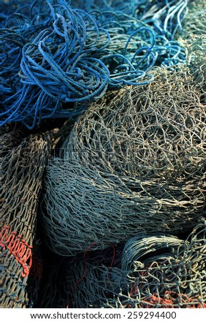 Heap of old fishing net. - stock photo