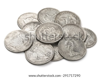 Heap of old silver coins isolated on white - stock photo