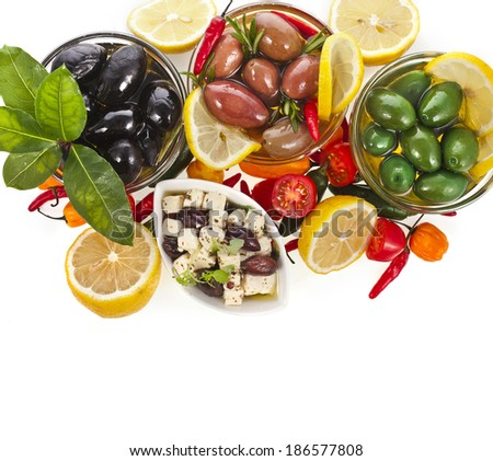 heap of olives dish with vegetables, herbs, spices top view surface  isolated on a white background  - stock photo