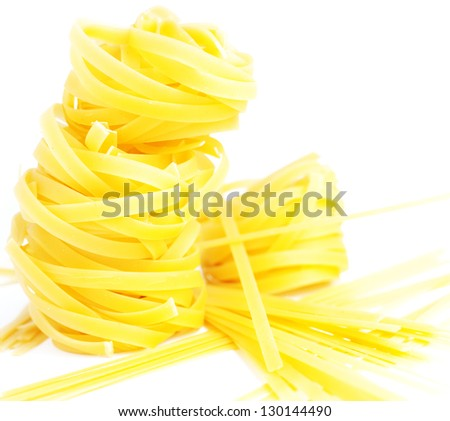 heap of pasta tagliatelle and noodles isolated on the white background