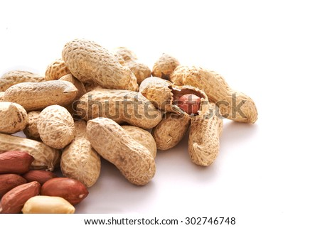 heap of peanuts in the shell over white background