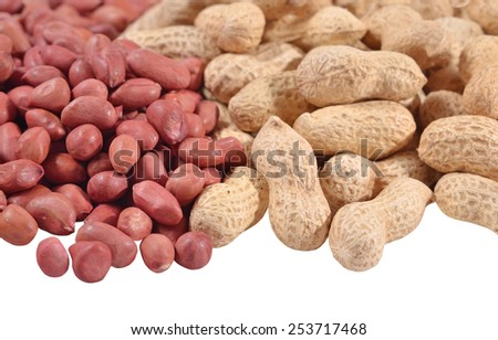 Heap of peanuts on a white background  - stock photo