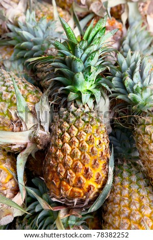 Heap of Pineapples in the market in India - stock photo