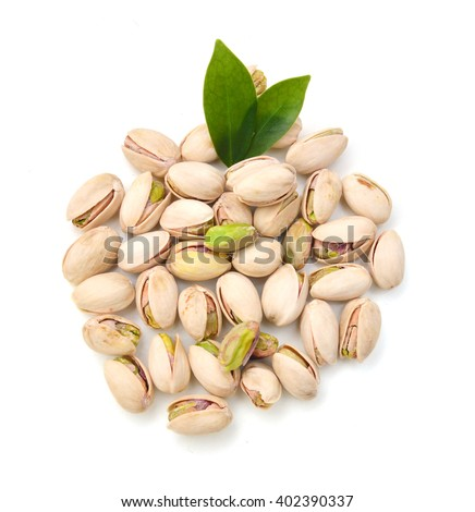 Heap of pistachios nuts isolated om the white
