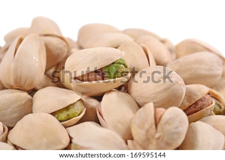 Heap of pistachios on a white background - stock photo