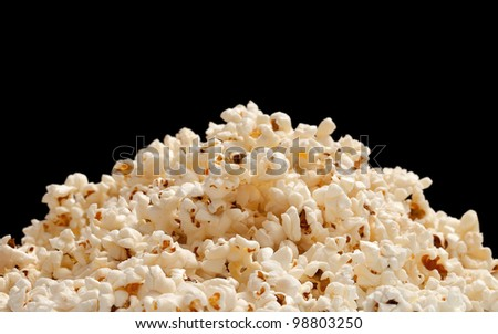 heap of popcorn isolated on black background. - stock photo