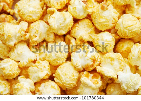 Heap of popcorn with caramel, top view - stock photo