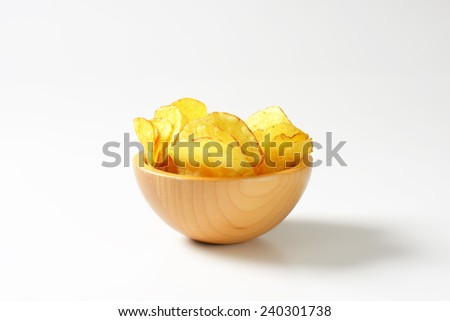 Heap of potato chips in a bowl - stock photo