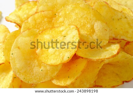 Heap of potato chips on white background