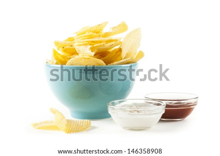 heap of potato crisps and ketchup and mayonnaise on white background - stock photo