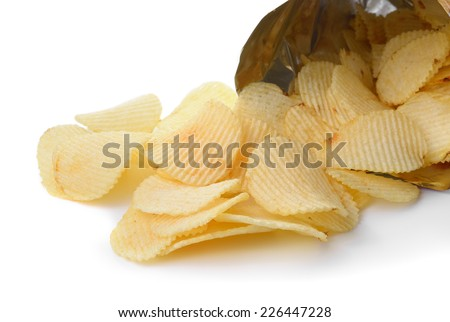 heap of potato crisps on white background - stock photo