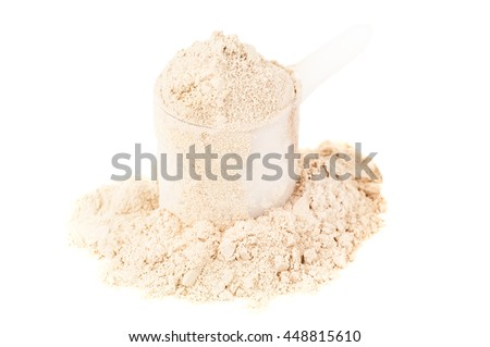 heap of protein powder with plastic spoon on white background