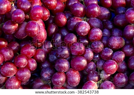heap of purple grapes in the wooden busket - stock photo