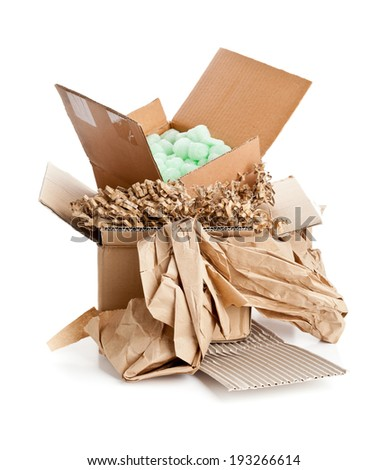 Heap of recyclable packaging materials - cardboard, paper, cornstarch pellets - stock photo