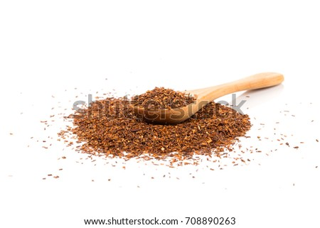 Heap of red dry rooibos healthy traditional organic tea in spoon on white isolated background