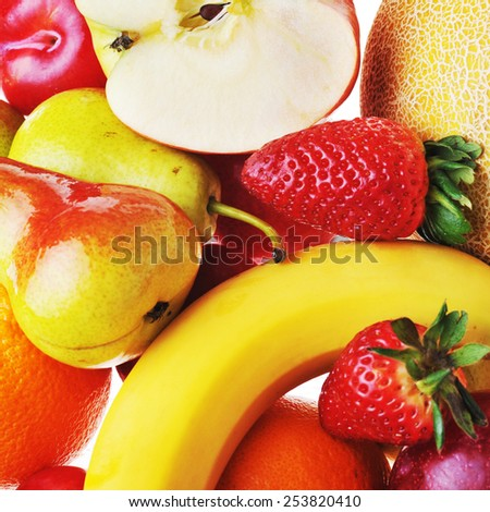 heap of ripe tasty fruit and  strawberries  - stock photo