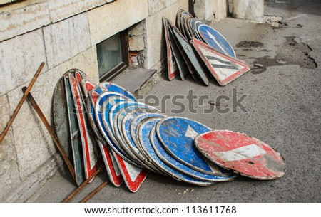 heap of road signs during street reconstruction - stock photo