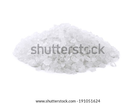 Heap of salt crystals isolated on white - stock photo
