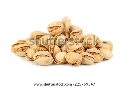 Heap of salted pistachio nuts isolated on white background