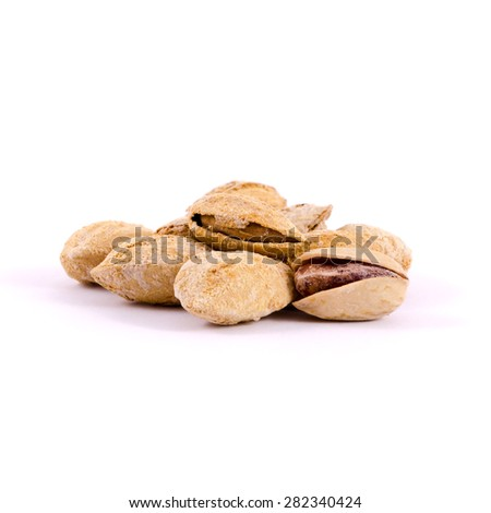 Heap of salted pistachio nuts isolated on white background - stock photo