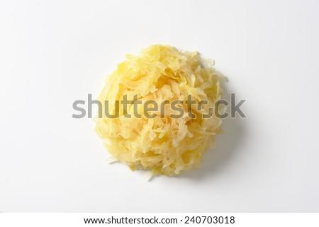 Heap of sauerkraut on white background - stock photo