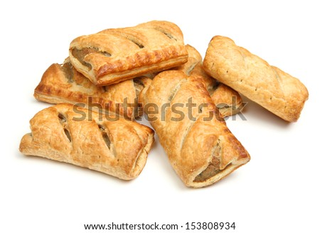 Heap of sausage rolls on white background. - stock photo