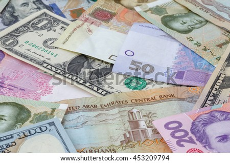 heap of several currencies banknotes - stock photo