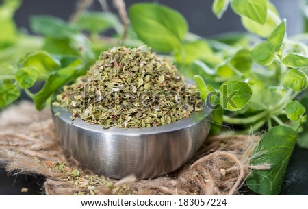 Heap of Shredded Oregano (high resolution close-up shot) - stock photo