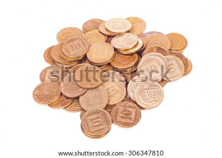 Heap of small Israeli coins isolated on white background - stock photo