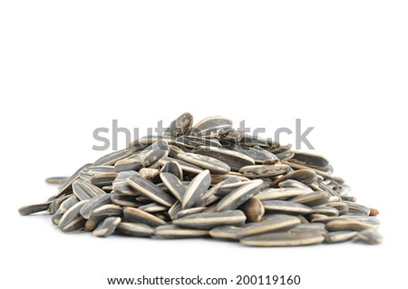 Heap of sunflower seeds on white background
