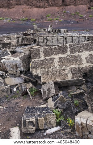 Heap of the damaged concrete blocks. Construction debris texture background  - stock photo