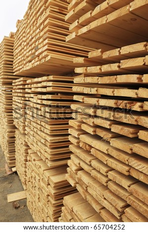Heap of the deal planks for sale - stock photo