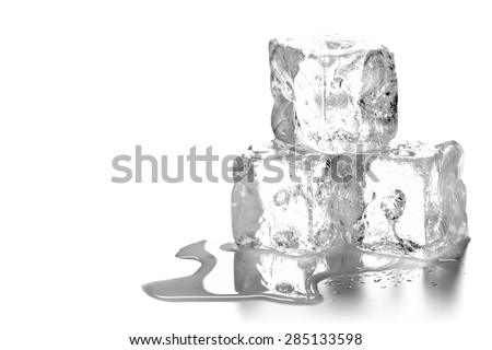 Heap of three ice cubes melting with water over white background